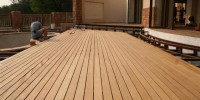 Contractors Fitting A Garapa Deck With EasyClips